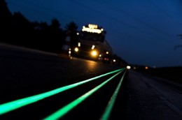Glowing Lines at a highway near Oss, The Netherlands, are pictured on April 10, 2014. The road marking absorb daylight during the day and gives light in the dark. Glowing Lines is part of the concept Smart Highway by Dutch designer Daan Roosegaarde and is executed by Dutch construction company Heijmans. AFP PHOTO / ANP - REMKO DE WAAL = netherlands out