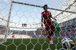 Portugal's Coentrao picks up the ball after a goal by Germany's Mueller during their 2014 World Cup Group G soccer match at the Fonte Nova arena in Salvador