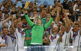 Germany's goalkeeper Neuer lifts the Golden Glove after being named as the best goalkeeper at the end of the 2014 World Cup final between Germany and Argentina at the Maracana stadium in Rio de Janeiro
