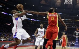Los Angeles Clippers guard Chris Paul, left, shoots as Houston Rockets guard James Harden, right, defends and center DeAndre Jordan watches during the first half in Game 4 of a second-round NBA basketball playoff series, Sunday, May 10, 2015, in Los Angeles. (AP Photo/Jae C. Hong) Rockets Clippers Basketball