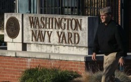 FILE - In this Sept. 19, 2013 file photo. military personnel walks past an entrance to the Washington Navy Yard in Washington. An official says shots have been reported in a building on the Washington Navy Yard campus.   (AP Photo/Charles Dharapak, File) Navy Yard Shooting