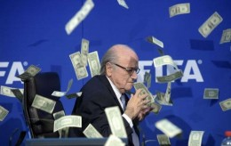 FIFA president Sepp  Blatter is photographed  while banknotes thrown by British comedian Simon Brodkin hurtle through the air during a press conference following the extraordinary FIFA Executive Committee at the  headquarters in Zurich, Switzerland, Monday, July 20, 2015. During the extraordinary FIFA Executive Committee meeting the agenda for the elective Congress for the FIFA presidency was finalized and approved: The congress will take place on Feb. 26.  2016.  (Ennio Leanza/Keystone via AP) Switzerland FIFA  Blatter Protest
