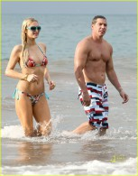 12-23-10 Maui, HI Paris Hilton and beau Cy Waits spend time relaxing in Hawaii. The couple could be seen swimming, hugging and kissing. Paris & Cy looked very much in love as they played in the water. Paris' figure looked a little different increasing rumors that she could be pregnant... Non-Exclusive Pix by Flynet ©2010 818-307-4813  Nicolas 310-869-0177  Scott