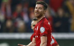 Bayern's Xabi Alonso celebrates after scoring his side's opening goal during the German soccer cup (DFB Pokal) match between FC Bayern Munich and SV Darmstadt 98 at the Allianz Arena stadium in Munich, Germany, Tuesday, Dec. 15, 2015. (AP Photo/Matthias Schrader) Germany Soccer Cup